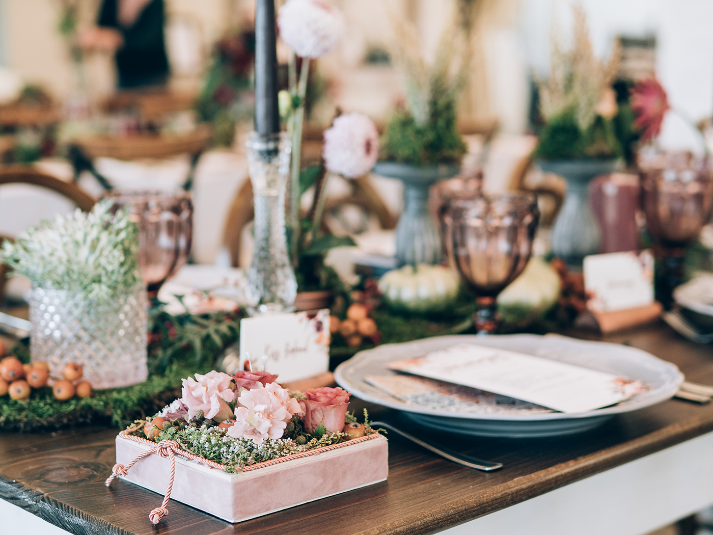 A wedding reception table decorated.