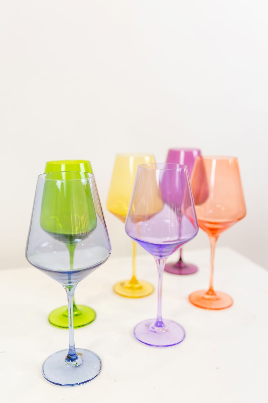 Six colorful wine glasses.