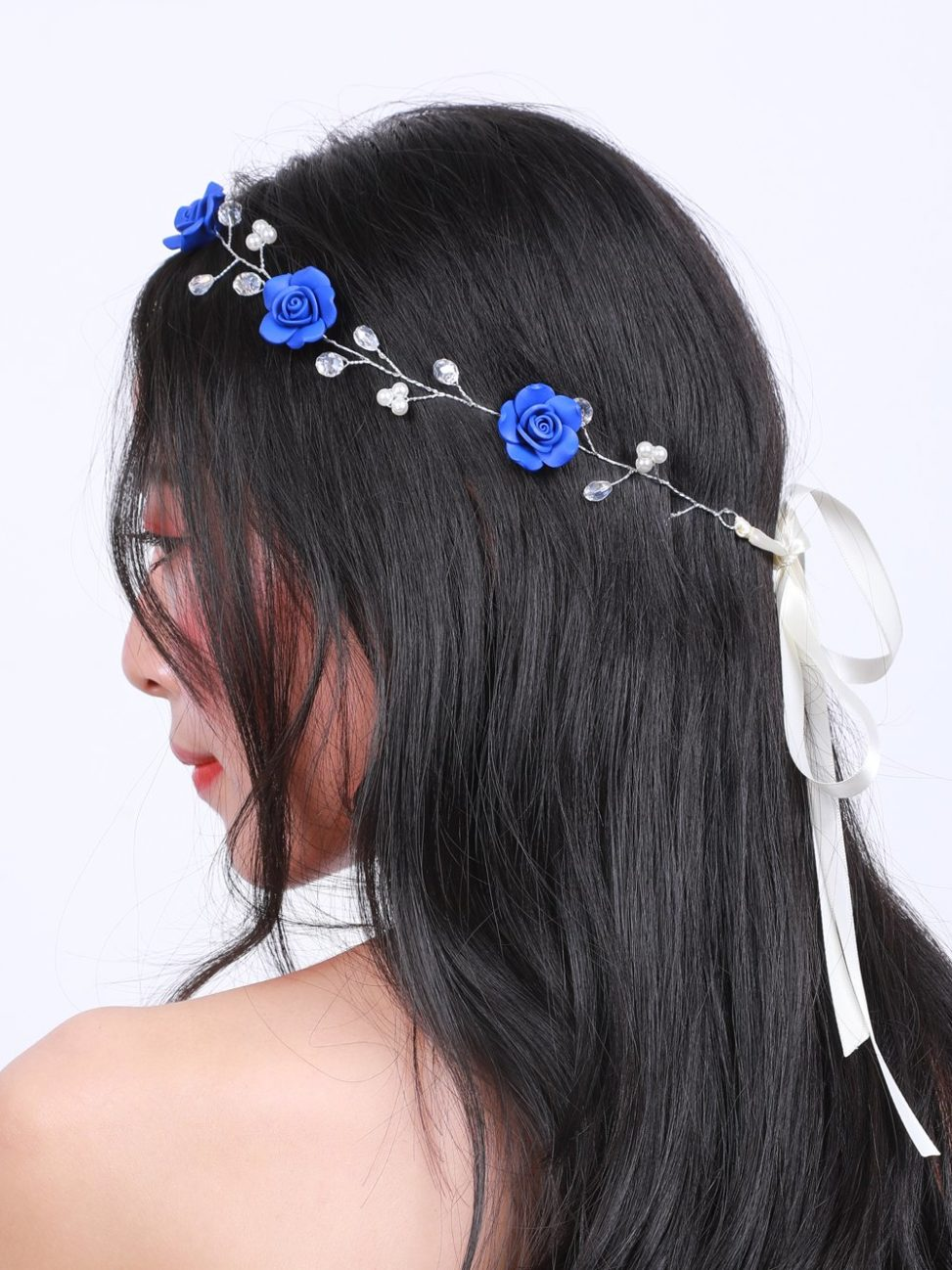 A navy blue flower headband
