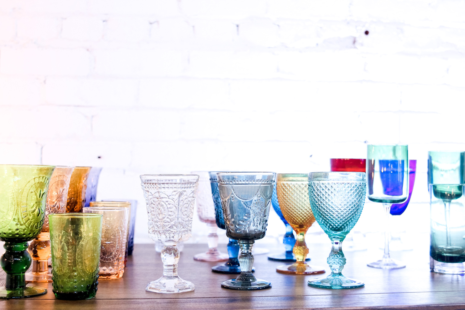Various glass goblets on a table.