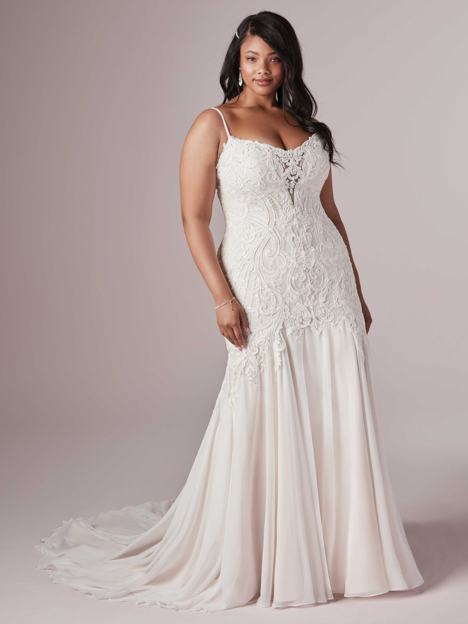 A woman wears the Corrine dress by Maggie Sottero