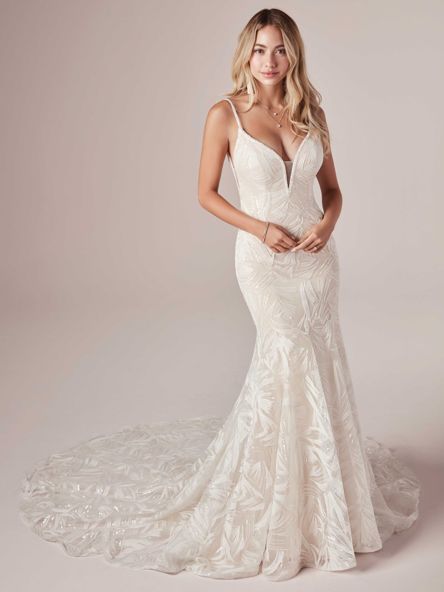 A woman wears the Elsie by Maggie Sottero