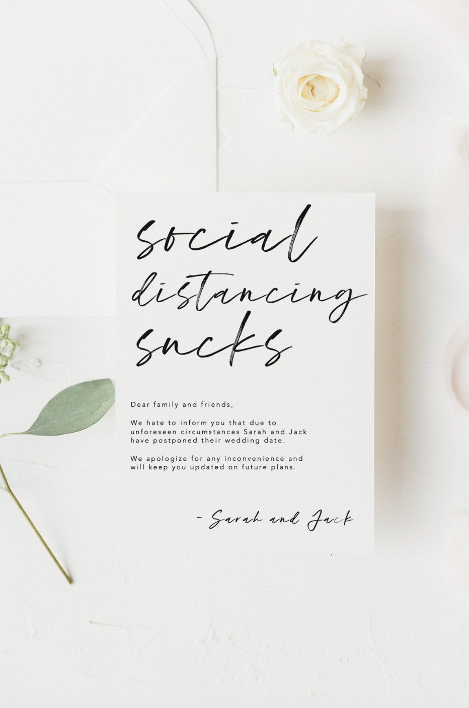 white and black change the date card that says social distancing sucks in script