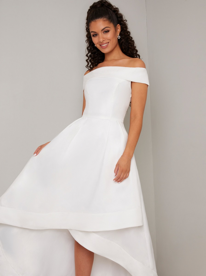 Woman with dark hair in off the rack white full skirt wedding dress