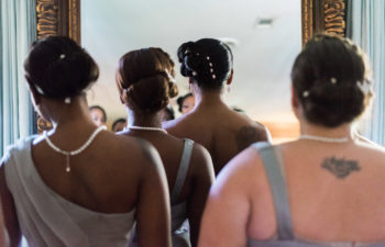 Bridesmaids waiting to enter a room