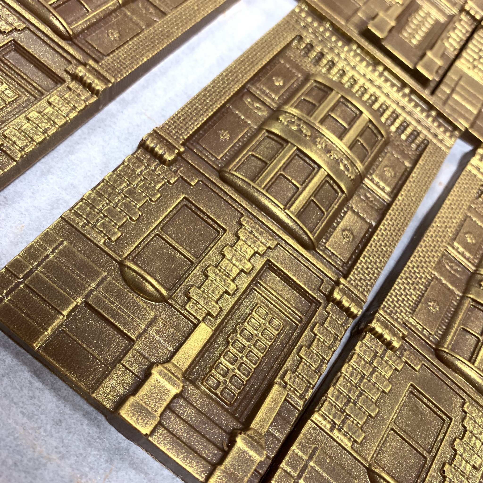 gold dusted milk chocolate shaped like houses in harlem