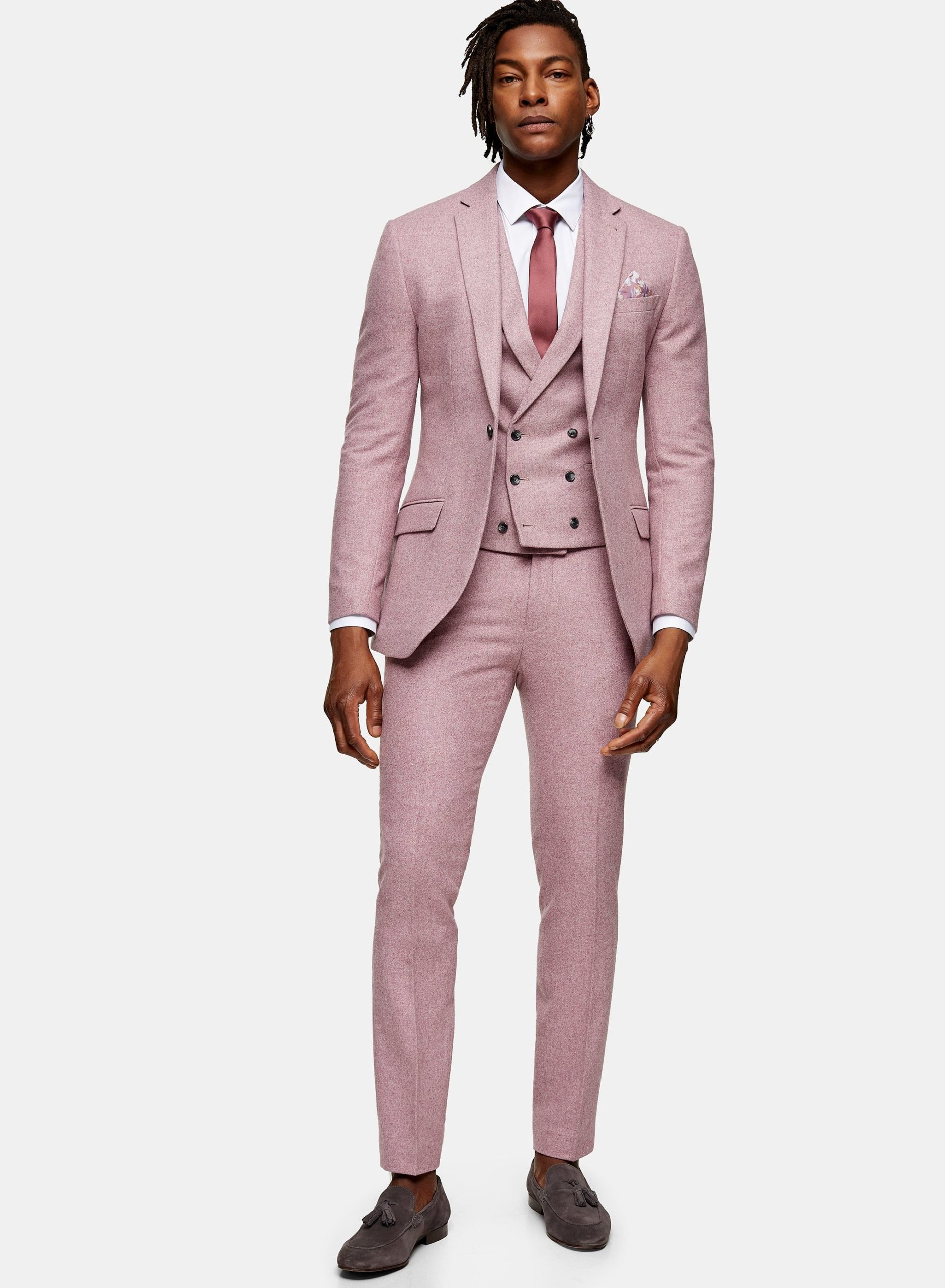 man wearing a pink 3 piece suit
