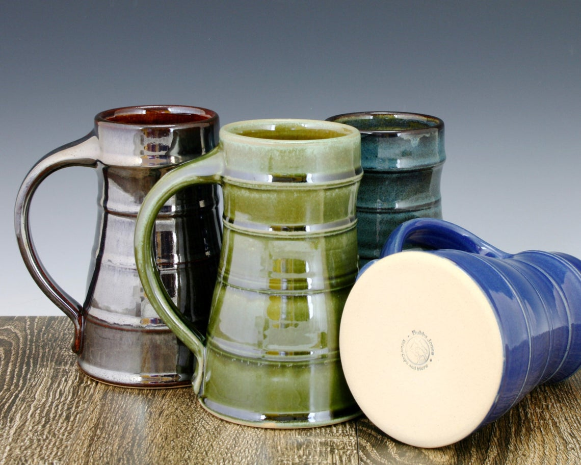 Multicolor ceramic beer steins make the ideal anniversary gift for the craft beer fan in your life