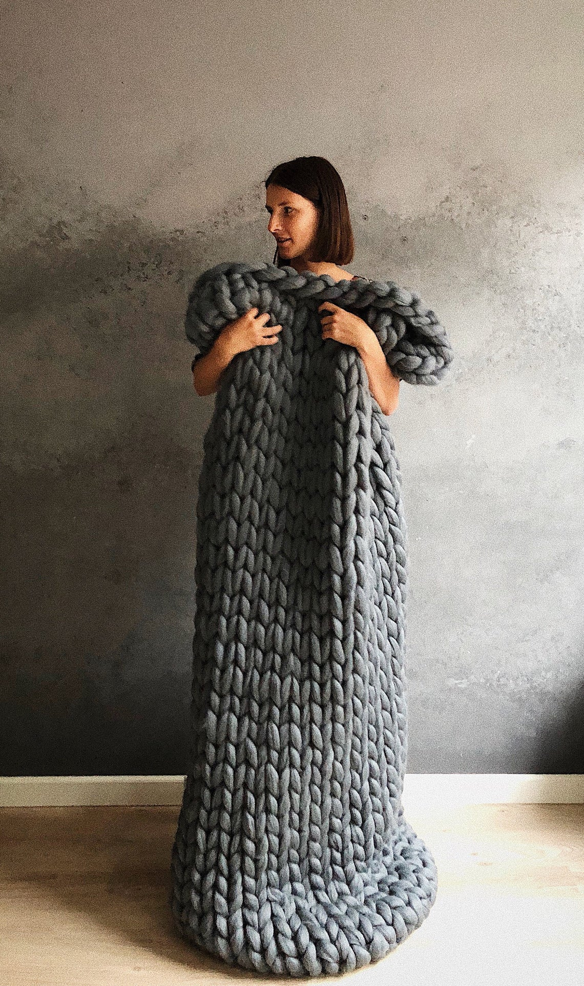 for an extra cozy anniversary gift consider this chunky grey knit blanket