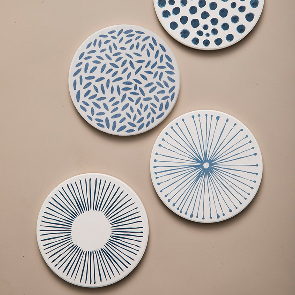 white and blue patterned ceramic drink coasters