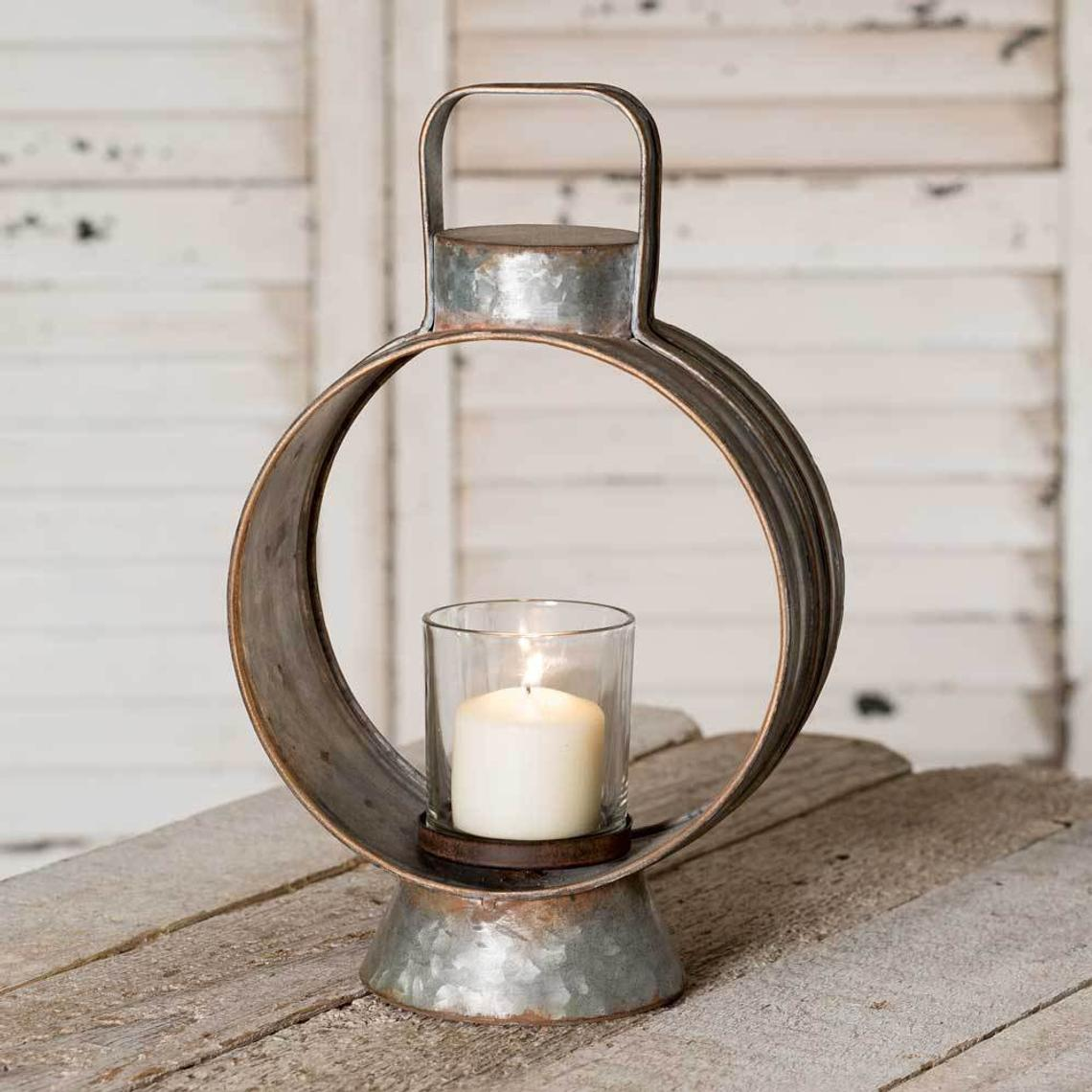 Round metal table top lantern with glass candle holder in the middle