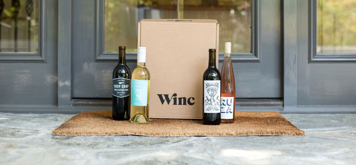 Box and bottles of Winc wine on front porch