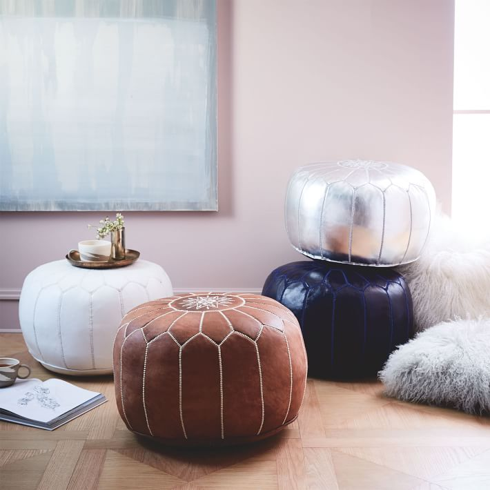 Brown, White, and Silver Leather ottomans in front of pink walls
