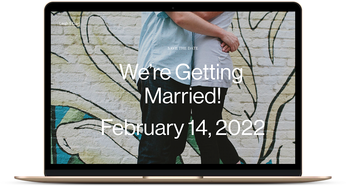 laptop showing wedding website with image of couple embracing