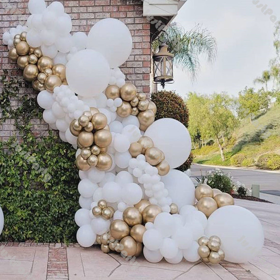 gold and white cascading balloons
