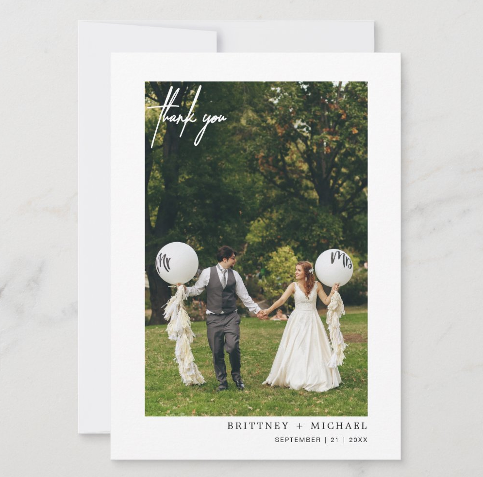 simple wedding thank you card with couple holding balloons